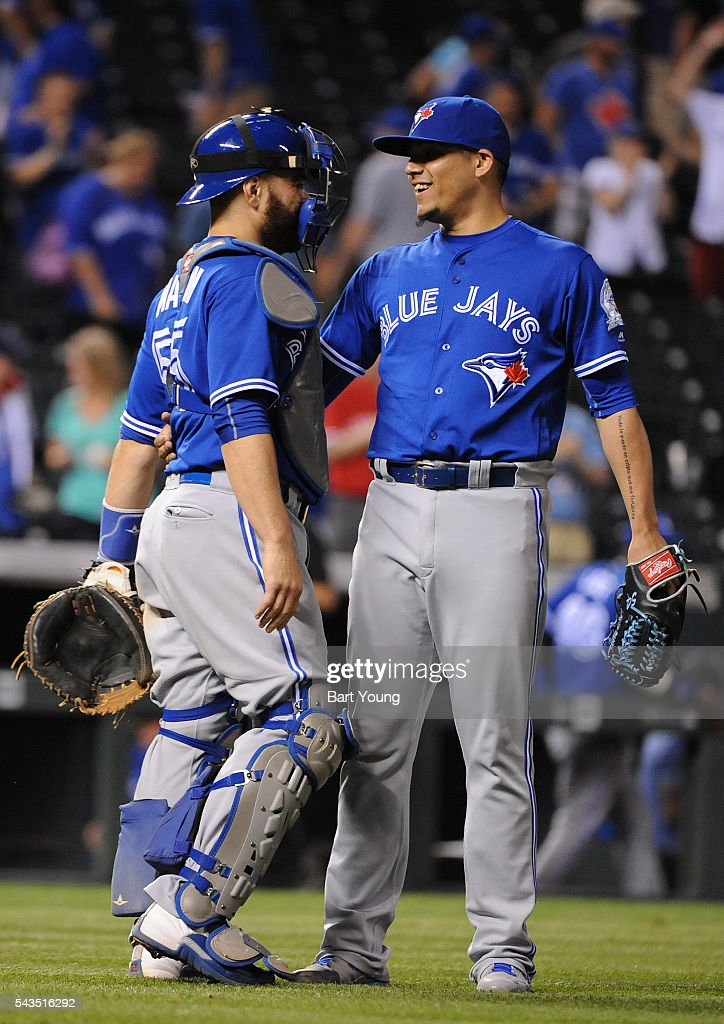 Roberto Osuna #54 and Russell Martin #55 of the Toronto Blue Jays celebrate the win in the ninth inning against the Colorado Rockies at Coors Field on June 28, 2016 in Denver, Colorado. The Toronto Blue Jays defeat the Colorado Rockies 14-9.