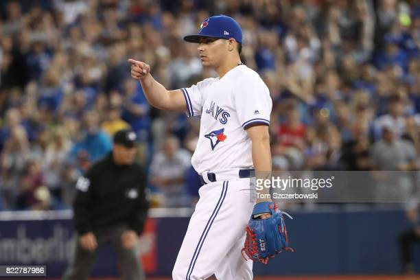 Roberto Osuna of the Toronto Blue Jays acknowledges a defensive play by Josh Donaldson in the ninth inning to end the game against the Oakland...