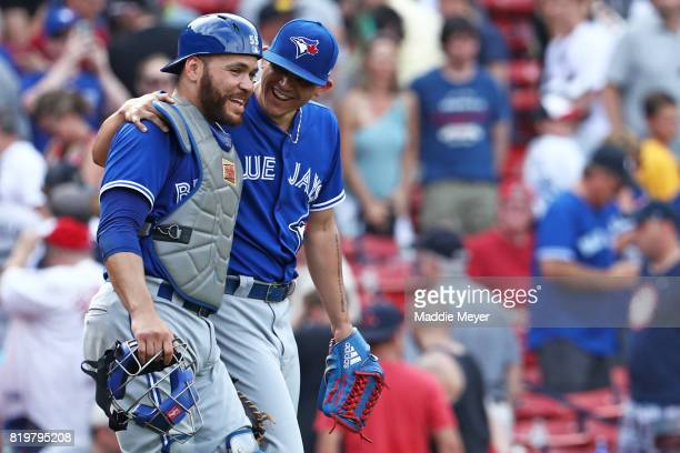 Roberto Osuna of the Toronto Blue Jays and Russell Martin celebrate after defeating the Boston Red Sox 86 at Fenway Park on July 20 2017 in Boston...