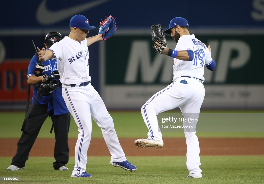 Roberto Osuna #54 of the Toronto Blue Jays celebrates a victory with Jose Bautista #19 during MLB game action against the Tampa Bay Rays at Rogers Centre on August 16, 2017 in Toronto, Canada.