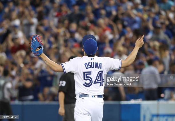 Roberto Osuna of the Toronto Blue Jays celebrates after getting the final out of the ninth inning to seal the victory during MLB game action against...