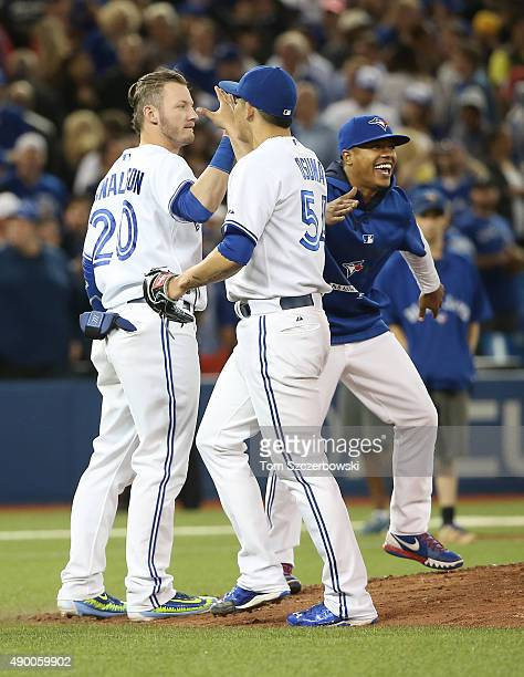 Roberto Osuna of the Toronto Blue Jays celebrates their victory with Josh Donaldson and Marcus Stroman during MLB game action against the Tampa Bay...