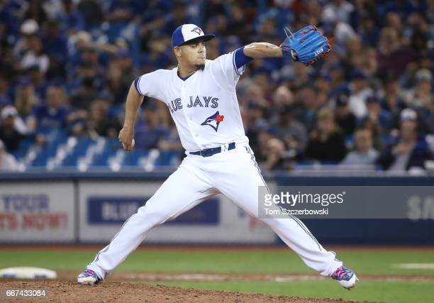 Roberto Osuna of the Toronto Blue Jays delivers a pitch in the ninth inning during MLB game action against the Milwaukee Brewers at Rogers Centre on...