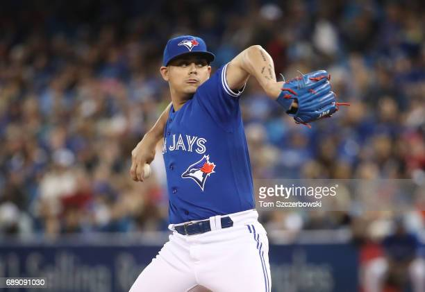 Roberto Osuna of the Toronto Blue Jays delivers a pitch in the ninth inning during MLB game action against the Texas Rangers at Rogers Centre on May...
