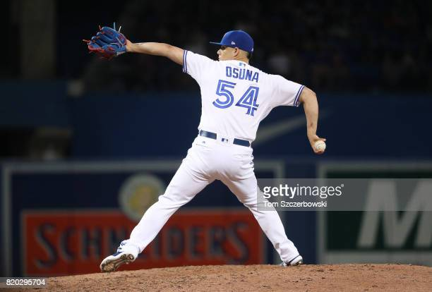 Roberto Osuna of the Toronto Blue Jays delivers a pitch in the ninth inning during MLB game action against the Baltimore Orioles at Rogers Centre on...