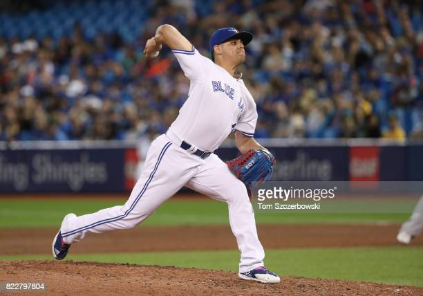Roberto Osuna of the Toronto Blue Jays delivers a pitch in the ninth inning during MLB game action against the Oakland Athletics at Rogers Centre on...