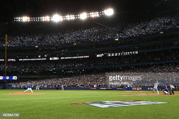 Roberto Osuna of the Toronto Blue Jays pitches in the eighth inning to Elvis Andrus of the Texas Rangers in game five of the American League Division...