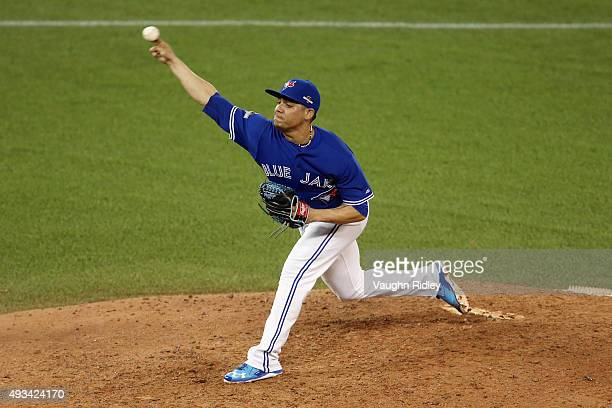 Roberto Osuna of the Toronto Blue Jays throws a pitch in the ninth inning against the Kansas City Royals during game three of the American League...