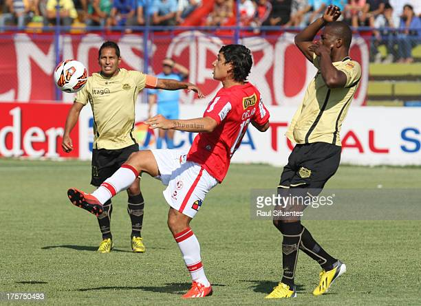 Roberto Ovelar of Juan Aurich fights for the ball with Javier Lopez of Itagui during a match between Juan Aurich and Itagui as part of The Copa Total...