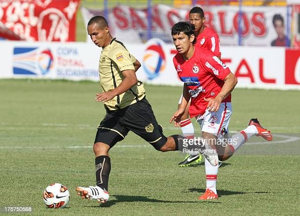 Roberto Ovelar of Juan Aurich fights for the ball with Yonaider Ortega of Itagui during a match between Juan Aurich and Itagui as part of The Copa...