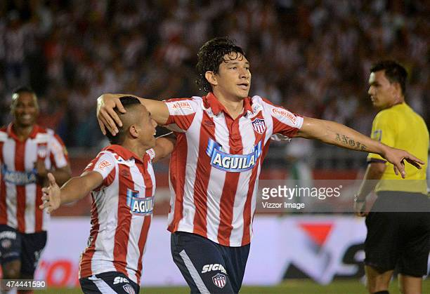 Roberto Ovelar player of Atletico Junior celebrates with Vladimir Hernandez during a quarterfinal first leg match between Junior and Medellin as part...