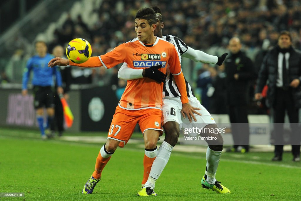 Roberto Pereyra (L) of Udinese Calcio is challenged by <a gi-track='captionPersonalityLinkClicked' href=/galleries/search?phrase=Paul+Pogba&family=editorial&specificpeople=5805302 ng-click='$event.stopPropagation()'>Paul Pogba</a> of Juventus during the Serie A match between Juventus and Udinese Calcio at Juventus Arena on December 1, 2013 in Turin, Italy.