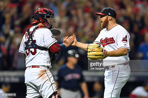 Roberto Perez and Cody Allen of the Cleveland Indians celebrate defeating the Boston Red Sox in Game 1 of ALDS at Progressive Field on Thursday...