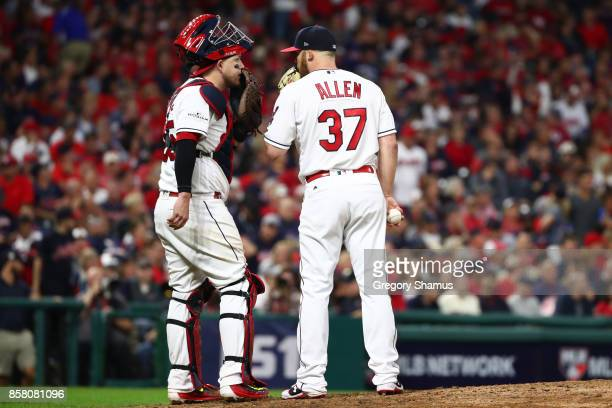 Roberto Perez and Cody Allen of the Cleveland Indians discuss the signs during the eighth inning against the New York Yankees during game one of the...