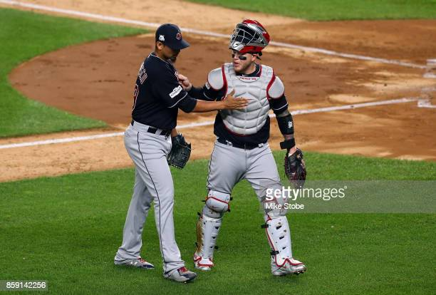 Roberto Perez congratulates Carlos Carrasco of the Cleveland Indians after a strikeout to end the second inning against the New York Yankees in game...