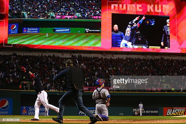 Roberto Perez of the Cleveland Indians celebrates after hitting a solo home run during the fourth inning against the Chicago Cubs in Game One of the...