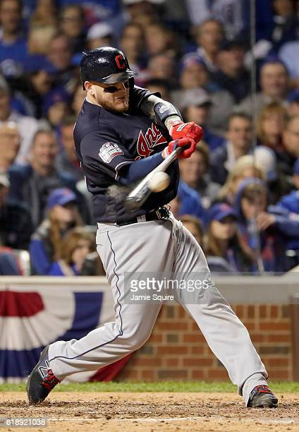 Roberto Perez of the Cleveland Indians hits a single in the seventh inning against the Chicago Cubs in Game Three of the 2016 World Series at Wrigley...