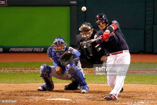 Roberto Perez of the Cleveland Indians hits a threerun home run during the eighth inning against the Chicago Cubs in Game One of the 2016 World...