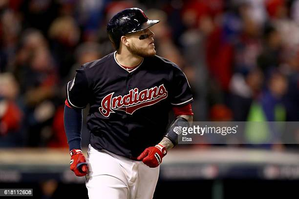 Roberto Perez of the Cleveland Indians reacts after hitting a threerun home run during the eighth inning against the Chicago Cubs in Game One of the...