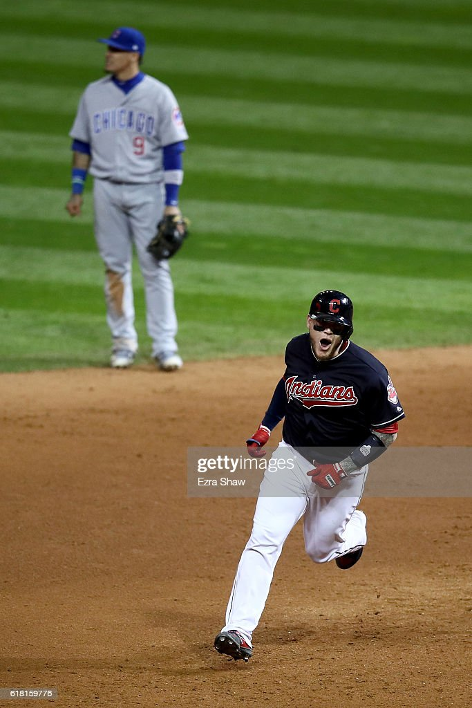 Roberto Perez #55 of the Cleveland Indians reacts as he runs the bases after hitting a three-run home run during the eighth inning against the Chicago Cubs in Game One of the 2016 World Series at Progressive Field on October 25, 2016 in Cleveland, Ohio.