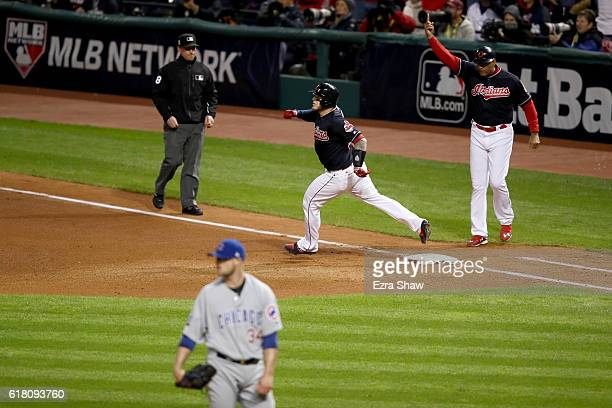 Roberto Perez of the Cleveland Indians runs the bases after hitting a solo home run during the fourth inning against the Chicago Cubs in Game One of...