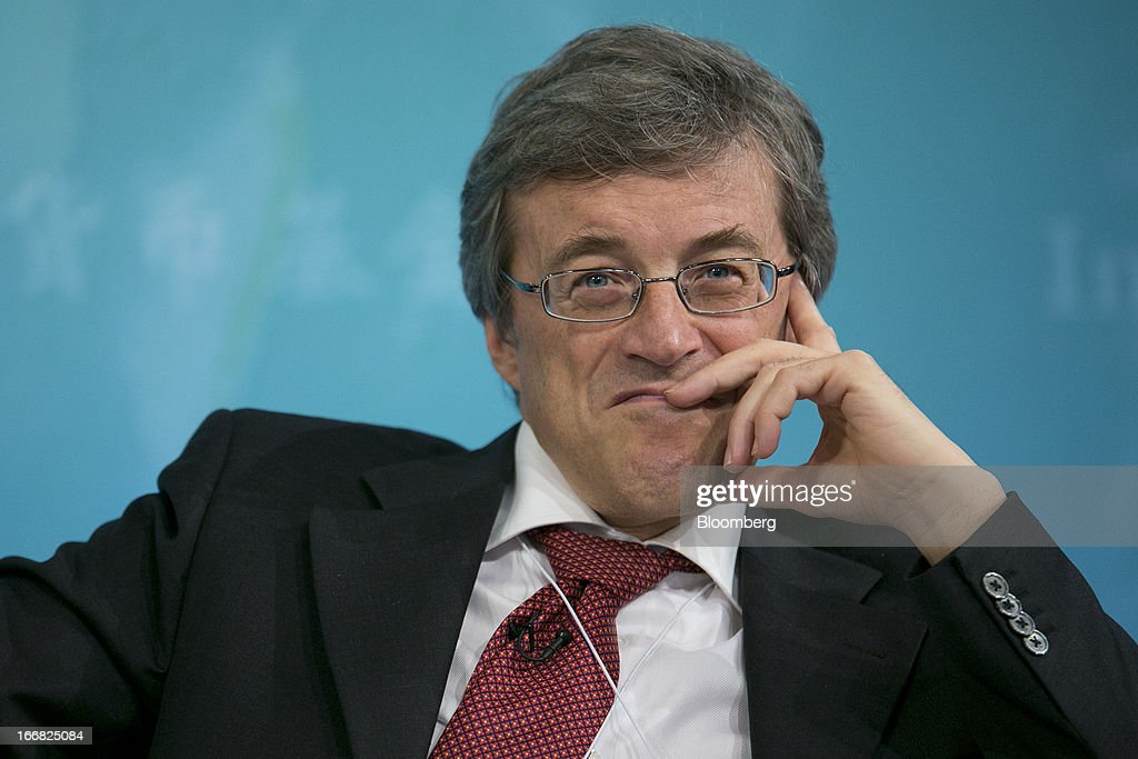 Roberto Perotti, professor of economics at Universita Bocconi, listens at a macro policy discussion during the International Monetary Fund (IMF) and World Bank Group Spring Meetings in Washington, D.C., U.S., on Wednesday, April 17, 2013. As much as 20 percent of non-bank corporate debt in the weakest euro-area economies is unsustainable and may force companies to cut dividends and sell assets, dealing further blows to investor confidence, the IMF said. Photographer: Andrew Harrer/Bloomberg via Getty Images