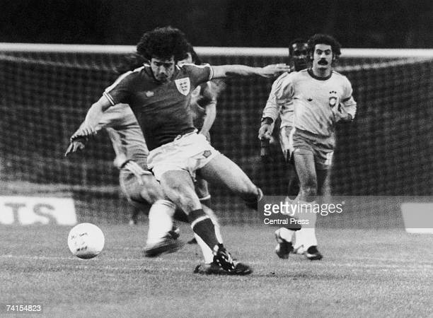 Roberto Rivellino of Brazil looks on as Kevin Keegan of England is tackled from behind by Zico during a friendly international at Wembley 19th April...