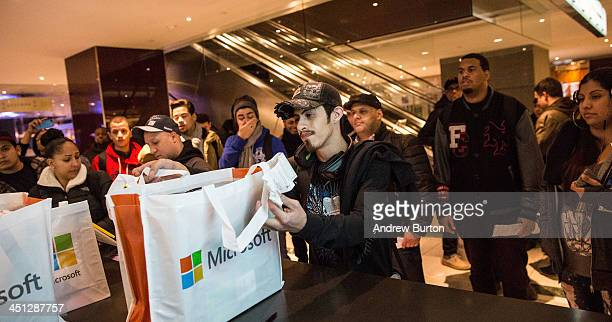 Roberto Rodriguez purchases Microsoft's XBox One a new video game console and home entertainment system from a Microsoft ''popup shop'' at the Time...