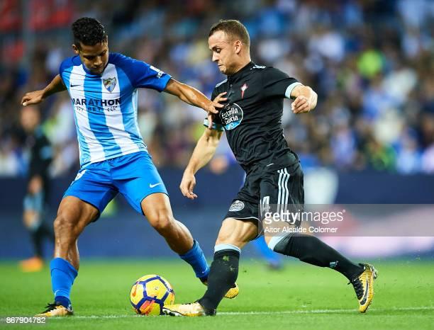 Roberto Rosales of Malaga CF competes for the ball with Stanislav Lobotka of Celta de Vigo during the La Liga match between Malaga and Celta de Vigo...