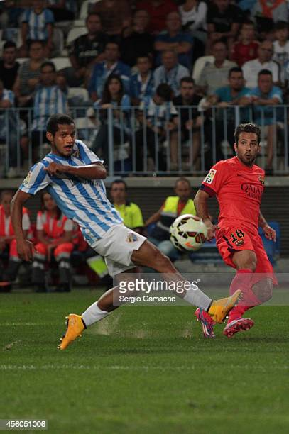 Roberto Rosales of Malaga CF duels for the ball with Jordi Alba of FC Barcelona during the La Liga match between Malaga CF and FC Barcelona at La...