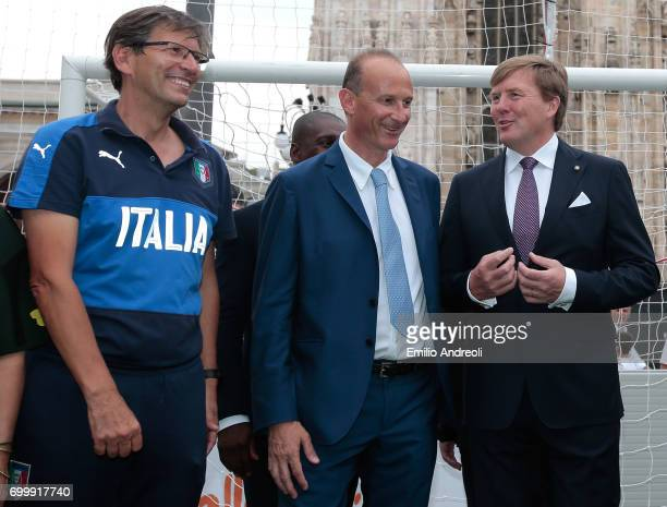 Roberto Samaden of FIGC speaks to King WillemAlexander of the Netherlands during a football clinic for integration organized by Italian Football...