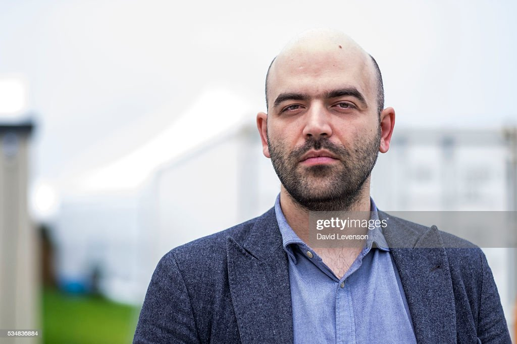 <a gi-track='captionPersonalityLinkClicked' href=/galleries/search?phrase=Roberto+Saviano&family=editorial&specificpeople=3964077 ng-click='$event.stopPropagation()'>Roberto Saviano</a>, Italian investigative journalist and author of Gomorrah and ZeroZeroZero, at the Hay Festival, on May 28, 2016 in Hay-on-Wye, Wales.