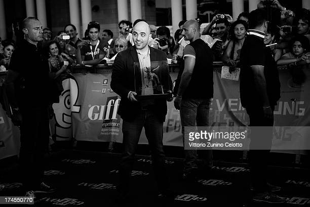 Roberto Saviano poses with the Truffaut Award during 2013 Giffoni Film Festival on July 27 2013 in Giffoni Valle Piana Italy