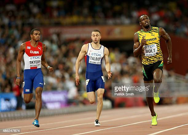 Roberto Skyers of Cuba Daniel Talbot of Great Britain and Usain Bolt of Jamaica compete in the Men's 200 metres semifinal during day five of the 15th...