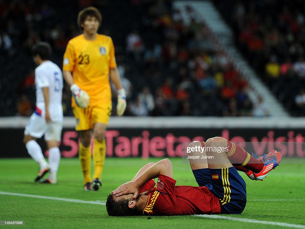 <a gi-track='captionPersonalityLinkClicked' href=/galleries/search?phrase=Roberto+Soldado&family=editorial&specificpeople=2095686 ng-click='$event.stopPropagation()'>Roberto Soldado</a> of Spain reacts during the international friendly match between Spain and Korea Republic on May 30, 2012 in Bern, Switzerland.