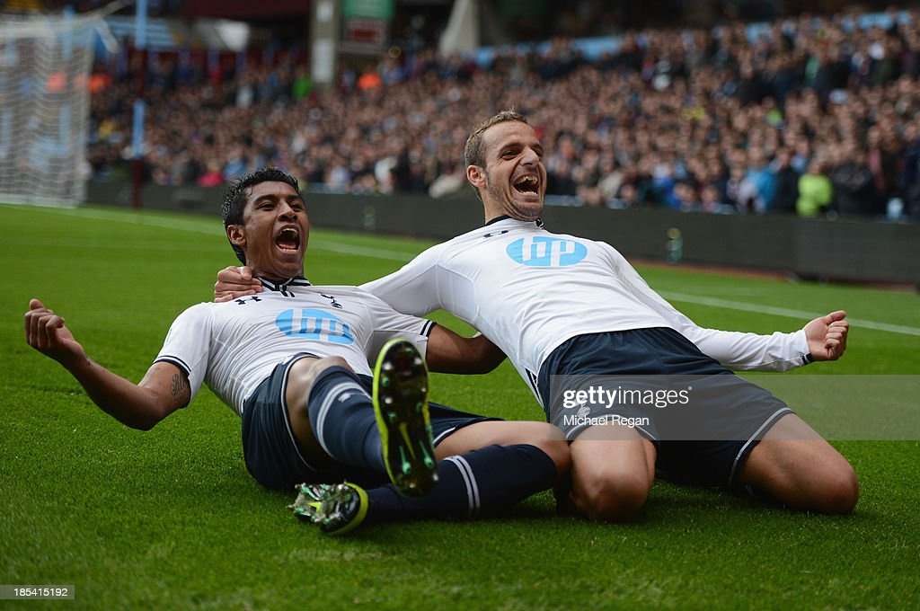 Roberto Soldado of Spurs (R) celebrates scoring their second goal with Paulinho of Spurs during the Barclays Premier League match between Aston Villa and Tottenham Hotspur at Villa Park on October 20, 2013 in Birmingham, England.