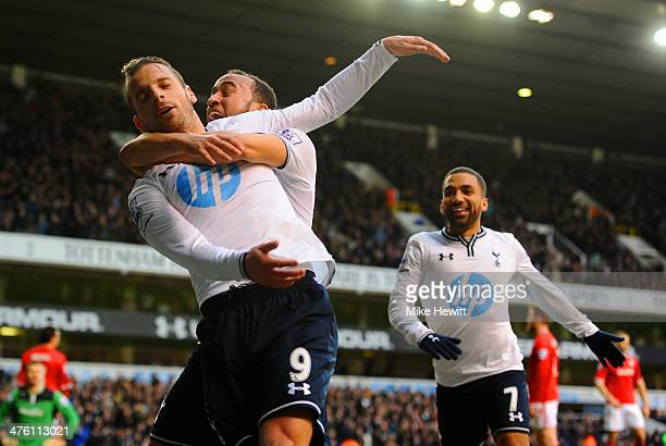 Roberto Soldado of Tottenham Hotspur celebrates scoring the opening goal with Andros Townsend and Aaron Lennon of Tottenham Hotspur during the...