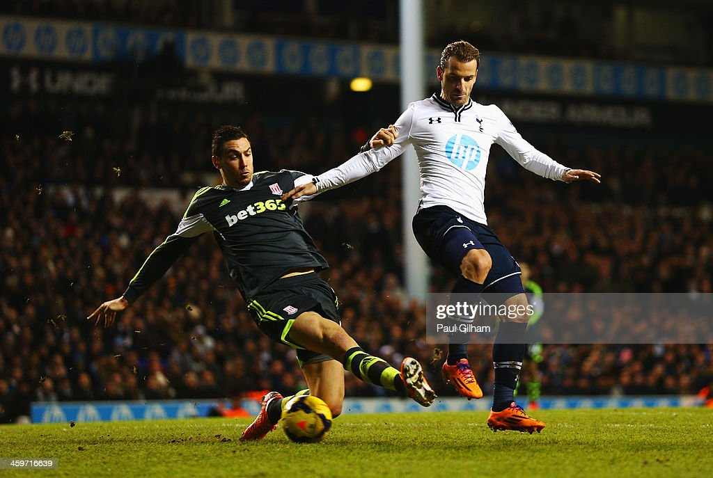 <a gi-track='captionPersonalityLinkClicked' href=/galleries/search?phrase=Roberto+Soldado&family=editorial&specificpeople=2095686 ng-click='$event.stopPropagation()'>Roberto Soldado</a> of Tottenham Hotspur is tackled by <a gi-track='captionPersonalityLinkClicked' href=/galleries/search?phrase=Geoff+Cameron&family=editorial&specificpeople=5101639 ng-click='$event.stopPropagation()'>Geoff Cameron</a> of Stoke City during the Barclays Premier League match between Tottenham Hotspur and Stoke City at White Hart Lane on December 29, 2013 in London, England.