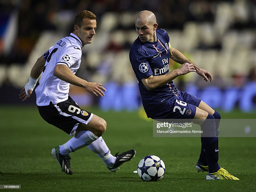 Roberto Soldado (L) of Valencia competes for the ball with Christophe Jallet of Paris Saint-Germain during the UEFA Champions League Round of 16 match between Valencia CF and Paris St Germain at Estadi de Mestalla on February 12, 2013 in Valencia, Spain.