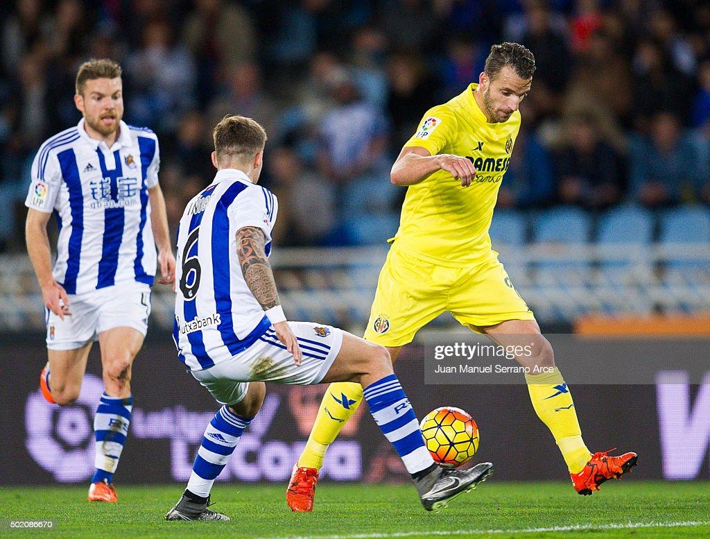 Roberto Soldado of Villarreal CF duels for the ball with Inigo Martinez of Real Sociedad during the La Liga match between Real Sociedad de Futbol and...