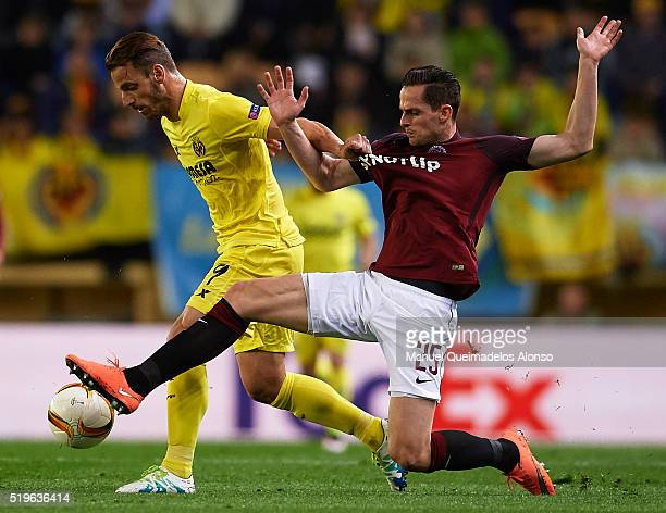 Roberto Soldado of Villarreal competes for the ball with Mario Holek of Sparta Prague during the UEFA Europa League Quarter Final first leg match...
