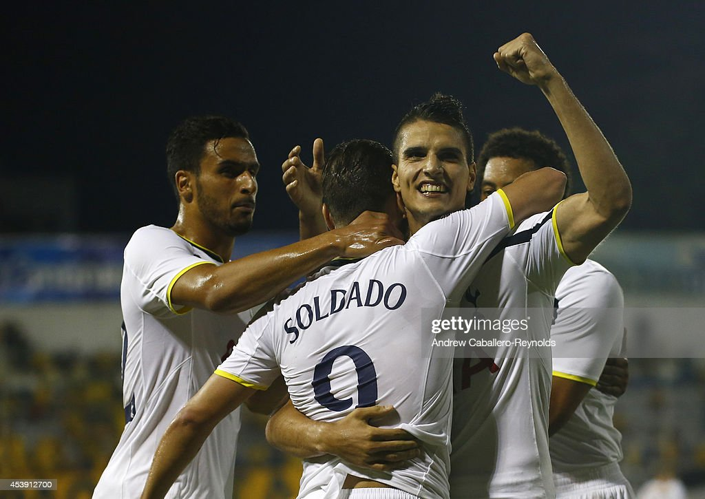 Roberto Soldado Rillo (C) and Erik Lamela (R) from Tottenham Hotspur celebrate a goal during the AEL Limassol FC v Tottenham Hotspur - UEFA Europa League Qualifying Play-Off match on August 21, 2014 in Larnaca, Cyprus.
