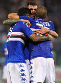 Roberto Soriano Alessio Romagnoli and Lorenzo De Silvestri of UC Sampdoria celebrate a victory at the end of the Serie A match between Genoa CFC and...