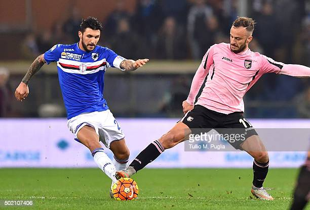 Roberto Soriano of Sampdoria and Alberto Gilardino of Palermo compete for the ball during the Serie A match between UC Sampdoria and US Citta di...