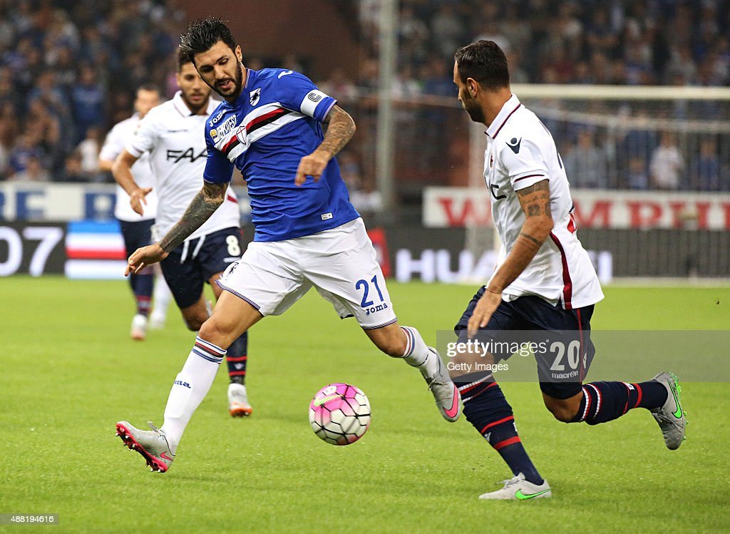 Roberto Soriano of Sampdoria competes for the ball with Domenico Maietta of Bologna during the Serie A match between UC Sampdoria and Bologna FC at...