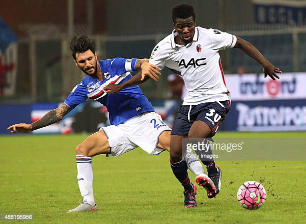 Roberto Soriano of Sampdoria competes for the ball with Gofred Donsah of Bologna during the Serie A match between UC Sampdoria and Bologna FC at...