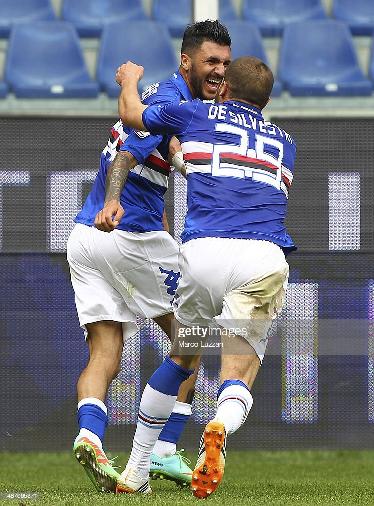 Roberto Soriano (L) of UC Sampdoria celebrates with his team-mate Lorenzo De Silvestri (R) after scoring his goal (2:1) during the Serie A match between UC Sampdoria and AC Chievo Verona at Stadio Luigi Ferraris on April 27, 2014 in Genoa, Italy.