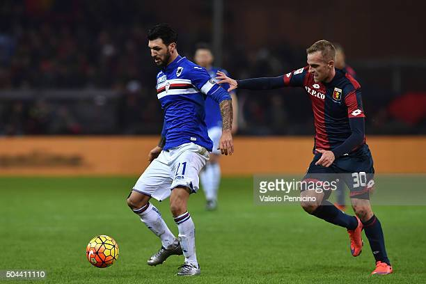 Roberto Soriano of UC Sampdoria is challenged by Luca Rigoni of Genoa CFC during the Serie A match between Genoa CFC and UC Sampdoria at Stadio Luigi...