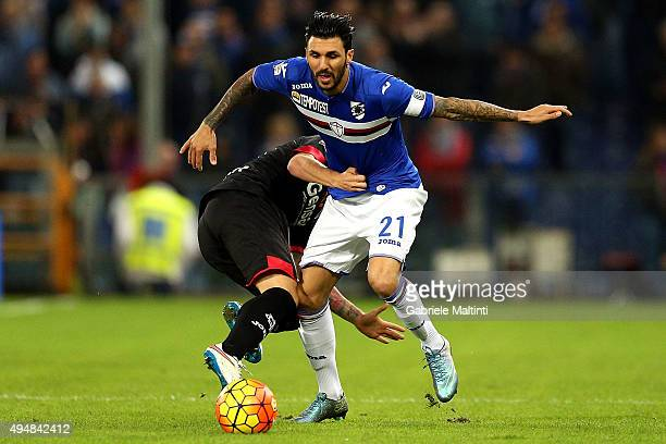 Roberto Soriano of US Sampdoria battles for the ball with Raffaele Maiello of Empoli Fc during the Serie A match between UC Sampdoria and Empoli FC...