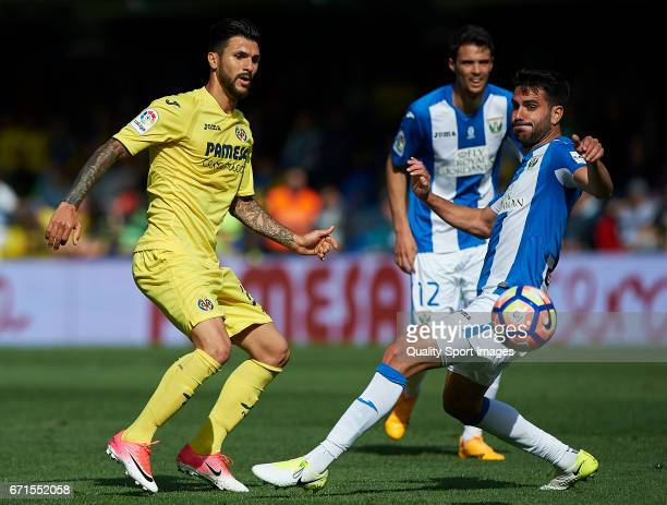 Roberto Soriano of Villarreal competes for the ball with Pablo Insua Blanco of Leganes during the La Liga match between Villarreal CF and CD Leganes...